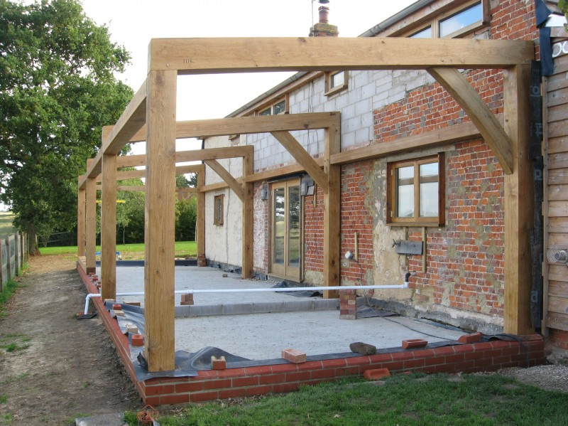 Oak frame extension for Oak framed house designs